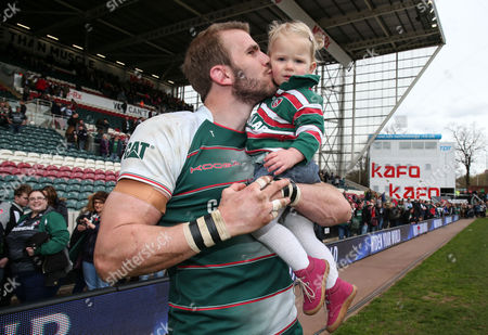 Leicester's Tom Croft celebrates with his daughter Victoria