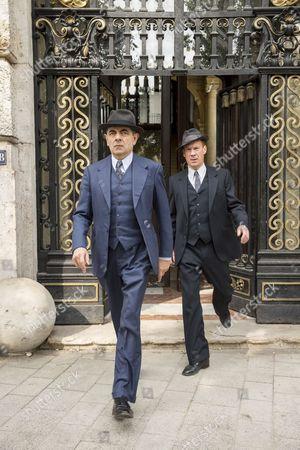 Rowan Atkinson as Maigret and Shaun Dingwall as Janvier