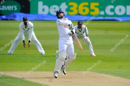 Hampshire's James Tomlinson jumps out of the way of a short ball from Warwickshires Rikki Clarke during the Specsavers County Champ Div 1 match between Hampshire County Cricket Club and Warwickshire County Cricket Club at the Ageas Bowl, Southampton