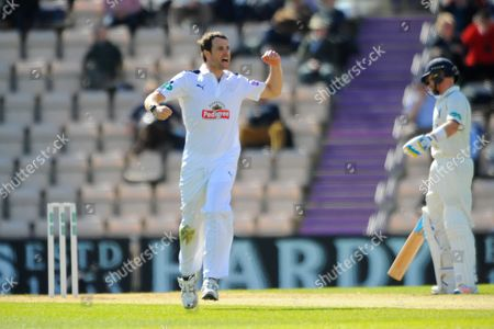 Hampshire's James Tomlinson celebrates taking the wicket of Warwickshire's Tim Ambrose during the Specsavers County Champ Div 1 match between Hampshire County Cricket Club and Warwickshire County Cricket Club at the Ageas Bowl, Southampton