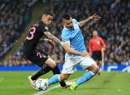 *Caption correction* Gregory van der Wiel of Paris Saint-Germain fouls Sergio Aguero of Manchester City