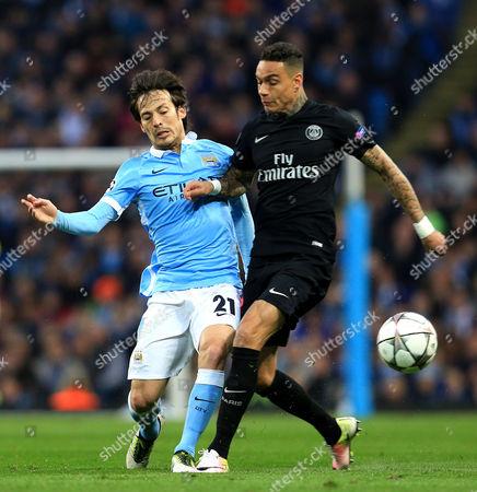 Gregory van der Wiel of Paris Saint-Germain tackles David Silva of Manchester City