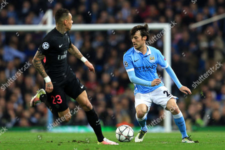 David Silva of Manchester City takes on Gregory van der Wiel of Paris Saint-Germain