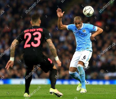 Fernando of Manchester City and Gregory van der Wiel of Paris Saint-Germain