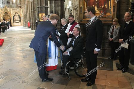 Stock Photo of Prince Harry meets Frank Gardner, BBC Security Correspondent, himself a victim from terrorists.
