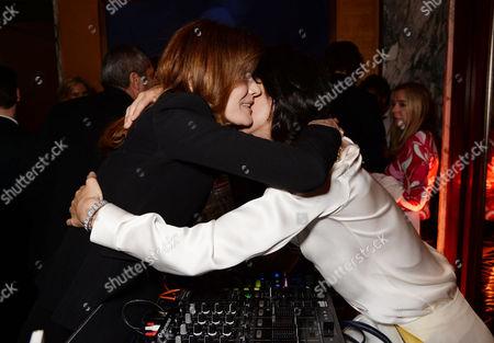 Stock Picture of Carla Bruni-Sarkozy hugging DJ Hen Yanni