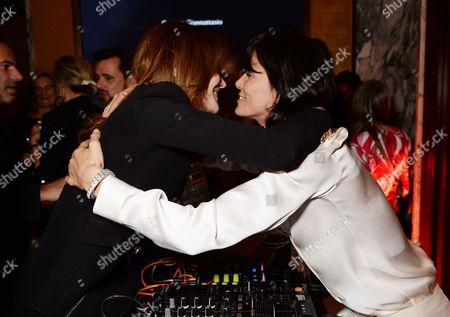 Stock Image of Carla Bruni-Sarkozy hugging DJ Hen Yanni