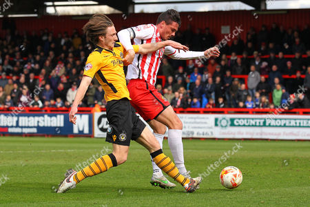 Ron Henry of Stevenage is challenged by Ben Davies of Newport County  during Stevenage vs Newport County, Sky Bet League 2 Football at the Lamex Stadium on 16th April 2016