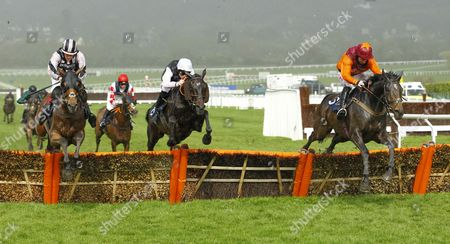 The Eaglehaslanded and Sam Twiston-Davies [left] wins the IJF Handicap Hurdle at Cheltenham from San Telm [centre] and Sir Ivan [right].