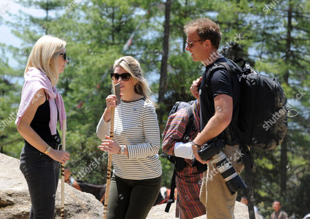 Amanda Cook Tucker (the hairdresser to the Duchess) and Natasha Archer (PA) talk to Chris Jackson Natasha's boyfriend as they enjoy a trek to the Tiger's nest Monastry in Bhutan