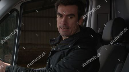 Stock Image of Emmerdale - Ep 7464 Thursday 31 March 2016 - 1st Ep Cain Dingle, Jeff Hordley, is annoyed Moira's given Charity and Ross permission to use the barn. Holly Barton, Sophie Powles, listens in and hears her mother calling her a liar. Cain forms a plan. Soon he tricks Holly into getting in the back of the van, where he locks her in and tells her to ring Dean, Craig Vye, as they're setting him up. On a secluded road they're soon joined by Dean and Cain offers him a deal, if he stays away from Holly. Will it work or will Cain's plan backfire?