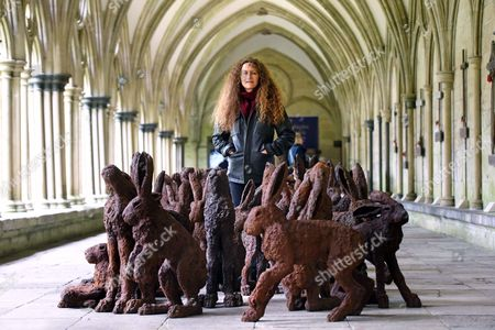 Sophie Ryder with her sculpture entitled 'Temple to the Two Hundred Rabbits' in the cloisters