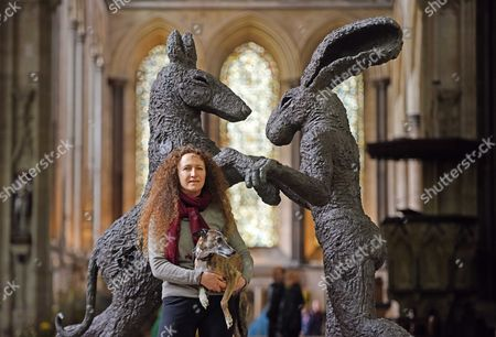 Sophie Ryder and dog Pedro with her sculpture, 'Pink Lady Dancing with Brown Dog'