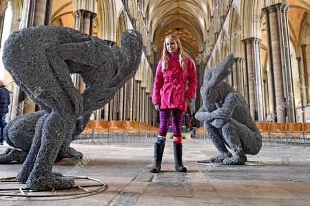 Stock Picture of Madison Lynch, aged 9, looks at the 'Introspective' by Sophie Ryder, in the West Door of the Cathedral
