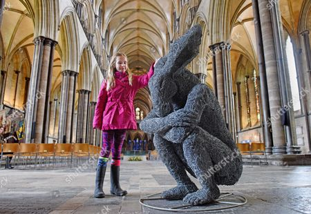 Madison Lynch, aged 9, looks at the 'Introspective' by Sophie Ryder, in the West Door of the Cathedral