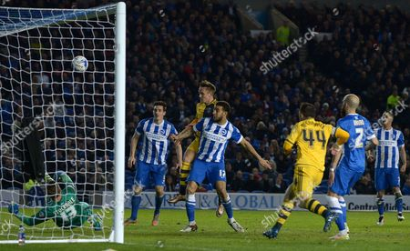 David Stockdale of Brighton saves from Lasse Vigen Christensen of Fulham during the Sky Bet Championship match between Brighton and Hove Albion and Fulham played at Amex Stadium, Brighton on April 15th 2016