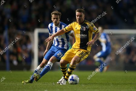 Stock Photo of Fulham midfielder Jamie O'Hara (23) during the Sky Bet Championship match between Brighton and Hove Albion and Fulham at the American Express Community Stadium, Brighton and Hove