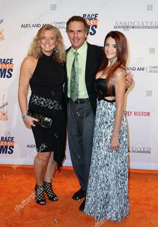 Stock Picture of Doug Flutie, Laurie Fortier and Alexa Flutie