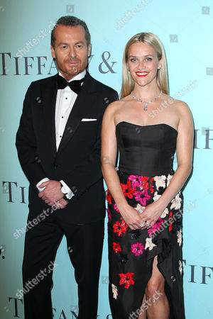 Frederic Cumenal (CEO; Tiffany & Co) and Reese Witherspoon