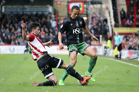 Brentford defender, Maxim Colin (2) tackling Bristol City striker, Peter Odemwingie (27) during the Sky Bet Championship match between Brentford and Bristol City at Griffin Park, London