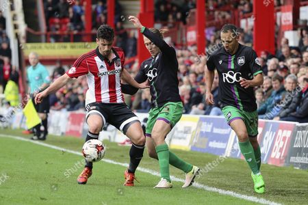 Bristol City striker, Luke Freeman (15) battling for the ball with Brentford defender, Maxim Colin (2) during the Sky Bet Championship match between Brentford and Bristol City at Griffin Park, London