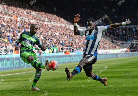 Modou Barrow of Swansea City (left) sees his shot blocked by Cheik Tiote of Newcastle United during the Barclays Premier League match between Newcastle United and Swansea City played at St. James' Park, Newcastle upon Tyne, on the 16th April 2016