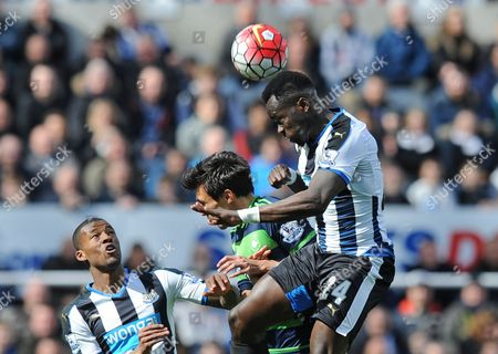 Cheik Tiote of Newcastle United (right) challenges Jack Cork of Swansea City  for the aerial ball during the Barclays Premier League match between Newcastle United and Swansea City played at St. James' Park, Newcastle upon Tyne, on the 16th April 2016