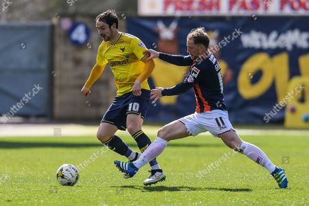 Luton Town's Danny Green attempts to tackle Oxford United's Danny Hylton during the Sky Bet League 2 match between Oxford United and Luton Town at the Kassam Stadium, Oxford