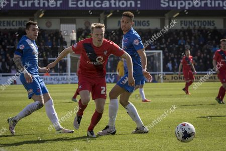 Reece Thompson of York City FC (22)in action skips past Hartlepool United defender Jake Carroll during  the Sky Bet League 2 match between Hartlepool United and York City at Victoria Park, Hartlepool