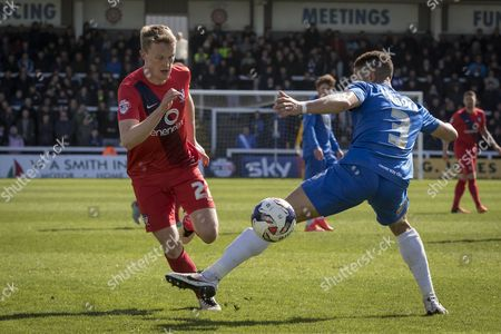 Stock Image of Reece Thompson of York City FC (22)in action skips past Hartlepool United defender Jake Carroll during  the Sky Bet League 2 match between Hartlepool United and York City at Victoria Park, Hartlepool