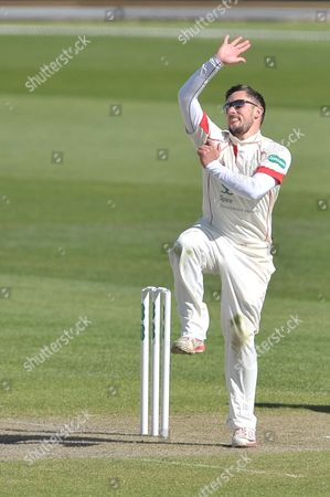 Simon Kerrigan in his deliver stride about to bowl to Chris Read (not shown) during the Specsavers County Champ Div 1 match between Lancashire County Cricket Club and Nottinghamshire County Cricket Club at the Emirates, Old Trafford, Manchester