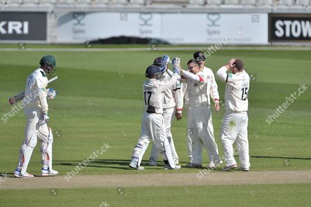 Simon Kerrigan celebrates bowling Stuart Broad with his team mates during the Specsavers County Champ Div 1 match between Lancashire County Cricket Club and Nottinghamshire County Cricket Club at the Emirates, Old Trafford, Manchester