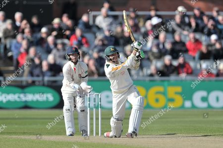 Harry Gurney clubs Simon Kerrigan (not shown) to the long on boundary during the Specsavers County Champ Div 1 match between Lancashire County Cricket Club and Nottinghamshire County Cricket Club at the Emirates, Old Trafford, Manchester
