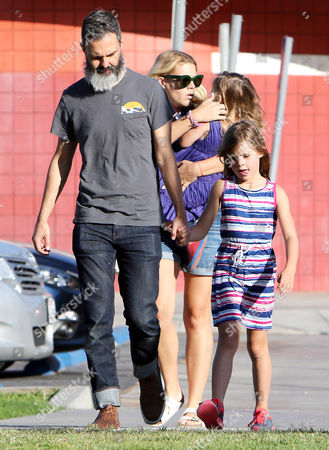 Marc Silverstein and Busy Philipps with daughters Birdie Leigh Silverstein and Cricket Pearl Silverstein