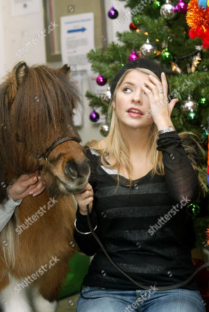 Holly Willoughby with Shetland pony at Great Ormond Street Hospital. The Olympia Shetland Pony Grand National has supported Great Ormond Street Hospital for 3 years and the pony visits the hospital every year to spread Christmas joy to the patients
