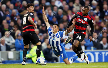 Anthony Knockaert of Brighton & Hove Albion is brought down by David Hoilett of Queens Park Rangers during the Sky Bet Championship match between Brighton and Hove Albion and Queens Park Rangers played at The Amex Stadium, Brighton on 19th April 2016
