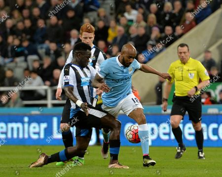 Stock Image of Fabian Delph of Manchester City (right) is tackled by Cheik Tiote of Newcastle United during the Barclays Premier League match between Newcastle United and Manchester  City played at St. James' Park, Newcastle upon Tyne, on the 19th April 2016