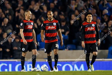 Karl Henry and Clint Hill of QPR look dejected alongside Alejandro Faurlin during the SkyBet Championship match between Brighton and Hove Albion and QPR played at AMEX Community Stadium, London on April 19th 2016