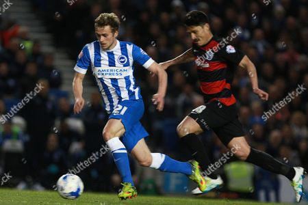 Brighton striker James Wilson breaks clear from Queens Park Rangers midfielder Alejandro Faurlin during the Sky Bet Championship match between Brighton and Hove Albion and Queens Park Rangers at the American Express Community Stadium, Brighton and Hove