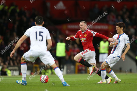 Wayne Rooney competes with Chung-Yong Lee during the Barclays Premier League match between Manchester United and Crystal Palace played at Old Trafford, Manchester on April 20th 2016