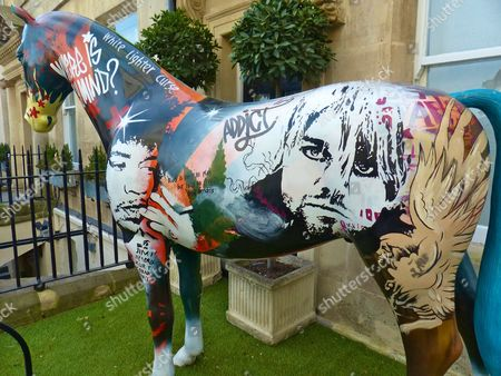 Stock Image of Street art horse sculpture depicting rock icons who died young, including Jimi Hendrix, Kurt Cobain and Janis Joplin