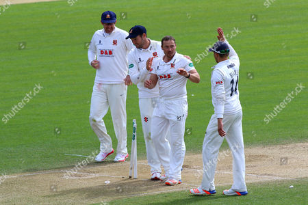 Graham Napier of Essex (2nd R) celebrates taking the wicket of Ben Sanderson and clinching victory for his team during Essex CCC vs Northamptonshire CCC, Specsavers County Championship Division 2 Cricket at the Essex County Ground on 27th April 2016