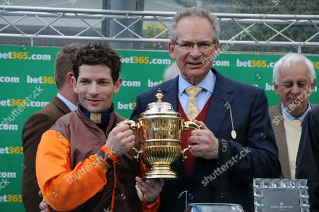 Sam Waley-Cohen and father Robert Waley-Cohen after The Young Master had won the Bet365 Gold Cup at Sandown.