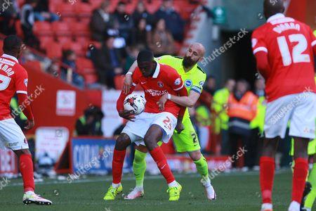 Brighton defender Bruno Saltor gets to grips with Charlton Athletic striker Yaya Sanogo during the Sky Bet Championship match between Charlton Athletic and Brighton and Hove Albion at The Valley, London