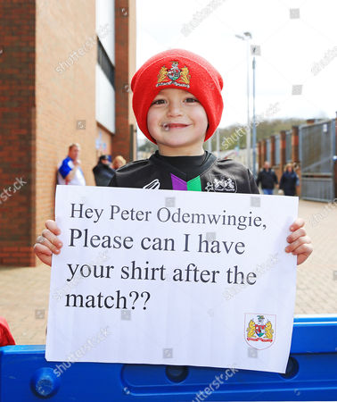 A young Bristol City fan holds up a banner for Peter Odemwingie