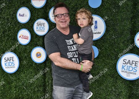 Stock Picture of Tom Arnold and Jax Copeland Arnold