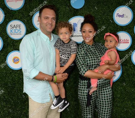 Tamera Mowry-Housley, husband Adam Housley, daughter Ariah, son Aden