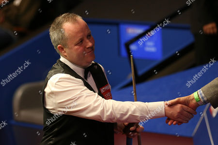 John Higgins after winning against Ricky Walden (not in picture) in the second round match on day 10 of the Betfred World Snooker Championship