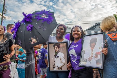 Revelers attend the Second Line Parade in honor of the late musician Prince