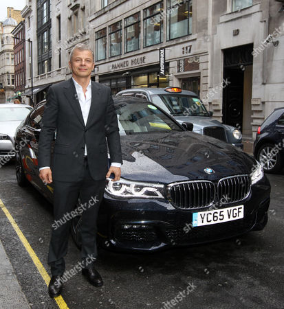 Stock Picture of Rainer Becker arrives in the luxury BMW 7 Series at the GQ Food and Drink Awards